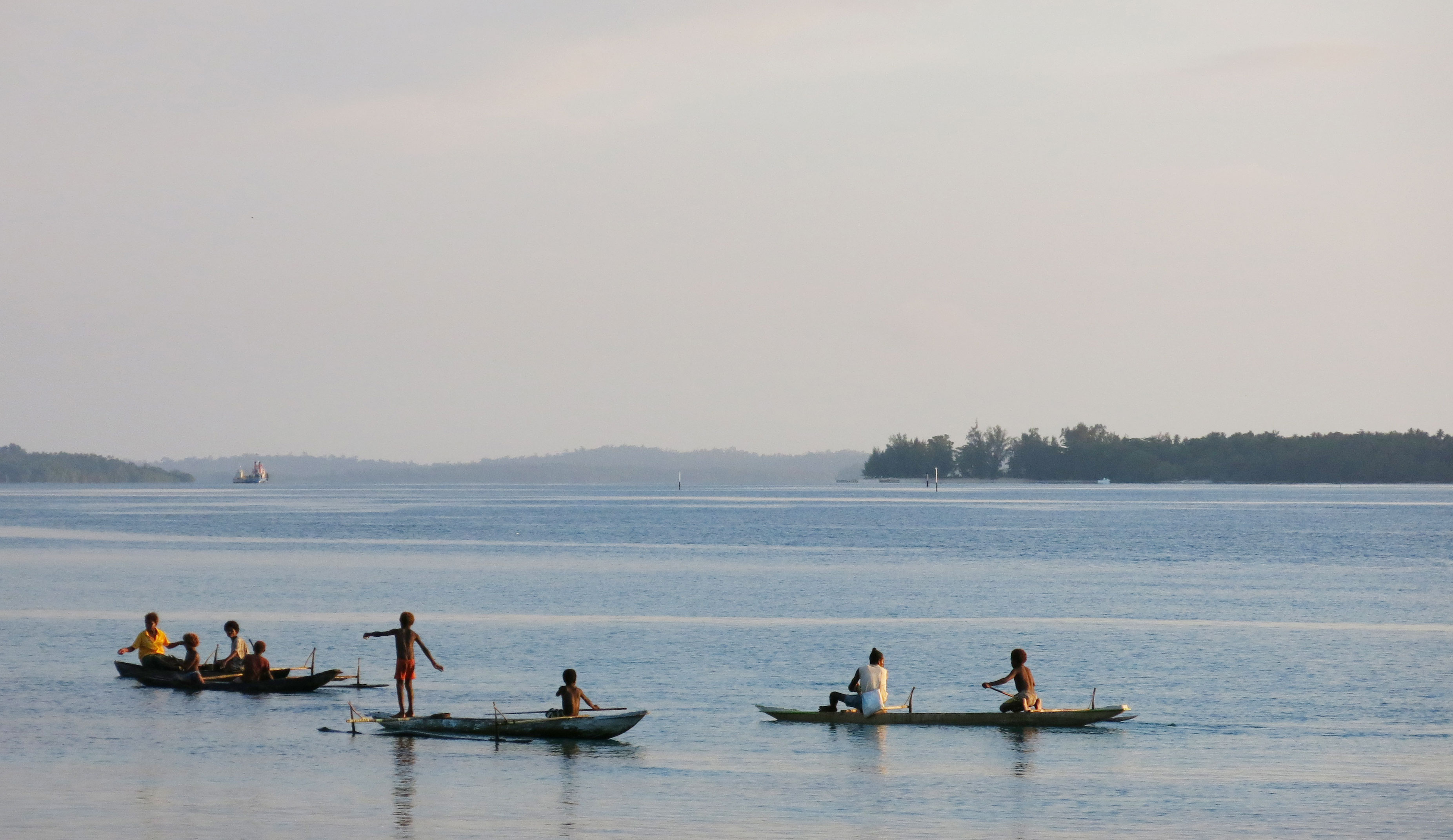 Mother and Children Fishing in Papua New Guinea
